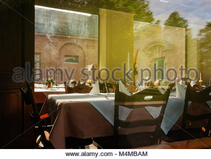 Empty table in restaurant ready for fine dining - Stock Photo