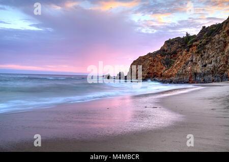 Sunset over the beach at Crescent Bay in Laguna Beach - Stock Photo