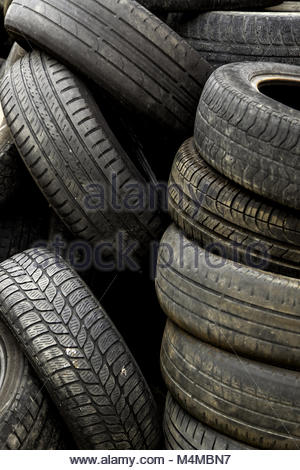 Old car tires in a landfill - Stock Photo