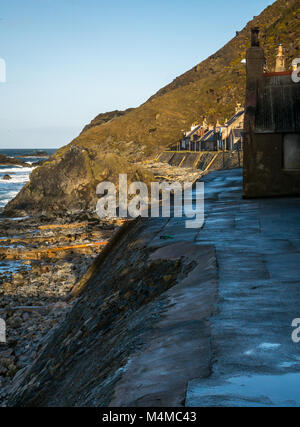 View of small seaside village Crovie, Aberdeenshire, Scotland, UK, with gable end old cottages on shore front - Stock Photo