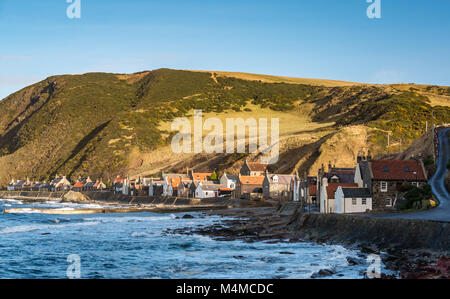 View of small picturesque seaside village Crovie, Aberdeenshire, Scotland, UK, with gable end old cottages on shore - Stock Photo