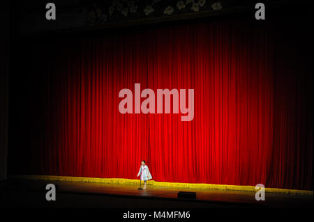 09.08.2012, Pyongyang, North Korea, Asia - A little girl stands on the stage of the Mangyongdae School Children's - Stock Photo