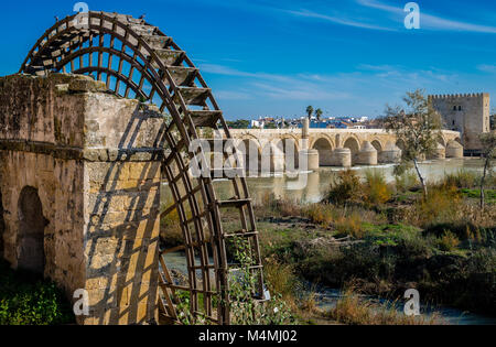 The Roman bridge and the the medieval mill on the banks of the river Guadaquivir in Cordoba, Andalusia, Spain. - Stock Photo