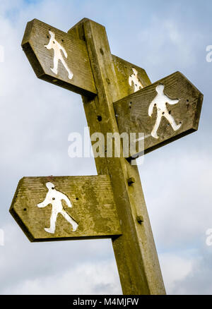 Waymarker sign at a junction of trails in the Cotswold Hills in Gloucestershire UK - Stock Photo