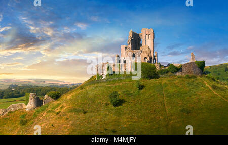 Medieval Corfe castle keep & battlements at sunrise, built in 1086 by William the Conqueror, Dorset England - Stock Photo