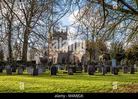 St Peter's parish church in the village of Alstonefield in the Derbyshire Peak District in winter - Stock Photo