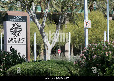 A logo sign outside of the headquarters of the Apollo Education Group, Inc., parent company of the for-profit college, - Stock Photo