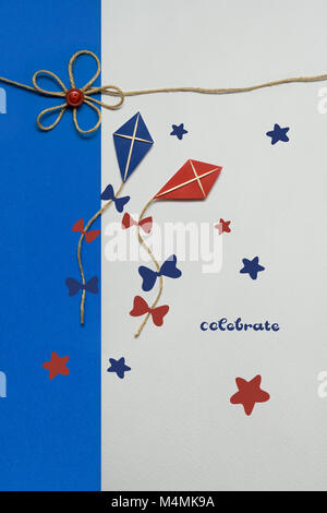 Creative concept photo of two kites made of paper on white blue background. - Stock Photo