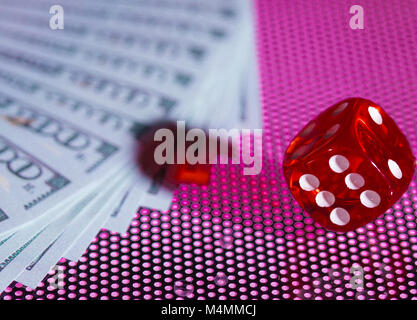 red dice and dolary cache on a dotted background - Stock Photo