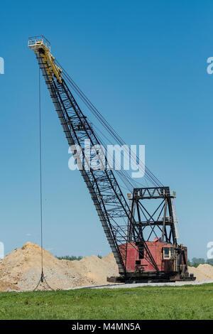 Massive dragline used in rock mining operation. - Stock Photo
