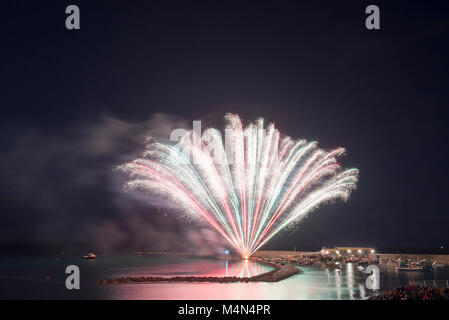 Firework display on the Cobb during the  bonfire night celebrations on 4th November 2017. - Stock Photo