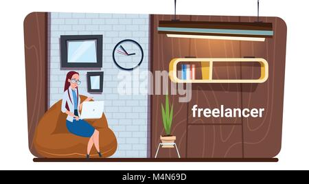 Female Freelance Worker Using Laptop Computer Work In Modern Creative Office Space - Stock Photo