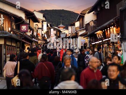 Matsubara dori street at sunset in fall busy with tourists near Kiyomizu-dera temple. Higashiyama, Kyoto, Japan - Stock Photo
