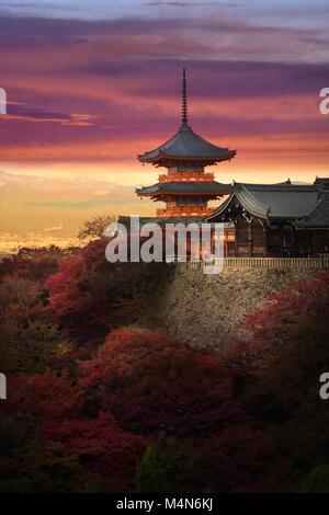 Sanjunoto pagoda, Sanju-no-to, with dramatic red yellow sunset skies, colorful autumn scenery. Kiyomizu-dera Buddhist - Stock Photo