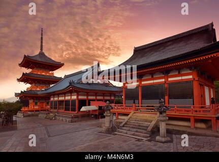 Kiyomizu-dera Buddhist temple, Sanjunoto pagoda, Kaisan-do and Kyo-do hall. Beautiful sunrise scenery with dramatic - Stock Photo
