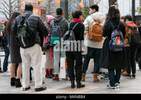 Tokyo, Japan. 17th Feb, 2018. Asian tourists shop in the Akihabara electronics shopping district on February 17, - Stock Photo