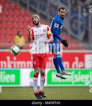 Halle, Deutschland. 17th Feb, 2018. Anton Fink (KSC) versus Halles Klaus Gjasula GES/ Fussball/ 3. Liga: Hallescher - Stock Photo