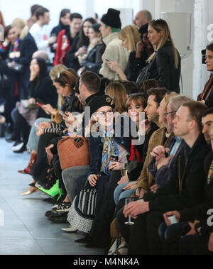 London, UK. 17th Feb, 2018. Guests of the Molly Goddard show seen sitting next to the runway. Credit: Rahman Hassani/SOPA/ZUMA - Stock Photo