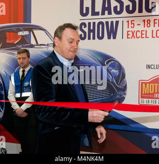 London, UK. 17th Feb, 2018. Actor, Philip Glenister cutting a ribbon to open  'The London Classic Car Show',   on - Stock Photo