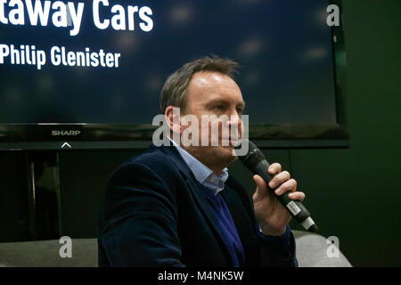 London, UK. 17th Feb, 2018. Actor, Philip Glenister being interviewed in the Supagard Theatre, at the Historic Motosport - Stock Photo