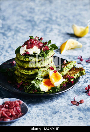 healthy eating, glutin free green pea pancake stack. With  goat cheese, egg, watercrese and mint greens and a side - Stock Photo