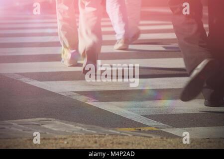 People walking on zebra crossing - Stock Photo
