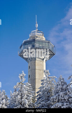 Willingen, Germany - February 7th, 2018 - Hochheide Tower on the summit of the Ettelsberg in front of a blue sky - Stock Photo