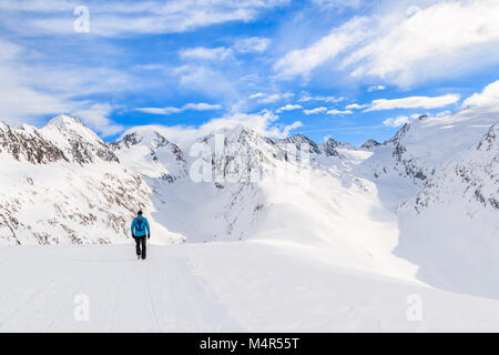 Unidentified tourist walking on snow in beautiful mountains during winter season, Obergurgl-Hochgurgl ski area, - Stock Photo
