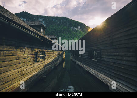 Beautiful view of traditional wooden boat house at the shores of famous Lake Königsse in Nationalpark Berchtesgadener - Stock Photo