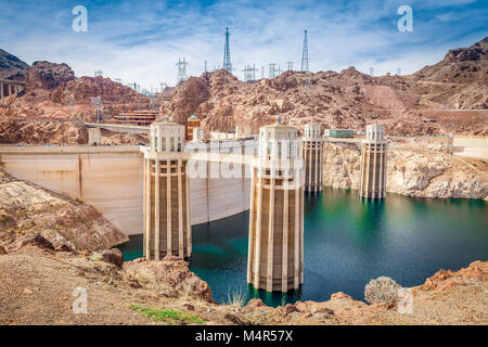 Classic view of famous Hoover Dam, a major tourist attraction located on the border between the states of Nevada - Stock Photo