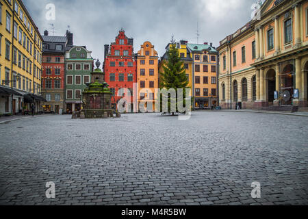 Classic view of colorful houses at famous Stortorget town square with Christmas Tree in Stockholm's historic Gamla - Stock Photo