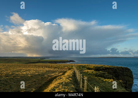 Cumulonimbus cloud over Dunnet Head, from Duncansby Head, near John o'Groats, Caithness, Scotland, UK - Stock Photo