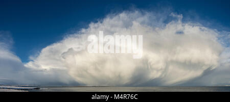 Huge cumulonimbus cloud over the Pentland Firth, from near the Ness of Duncansby, Caithness, Scotland, UK. The Isle - Stock Photo