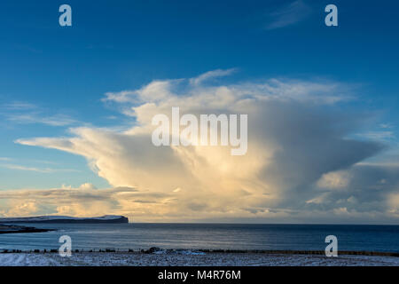 Cumulonimbus cloud over Dunnet Head and the Pentland Firth, from near the village of Mey, Caithness, Scotland, UK - Stock Photo