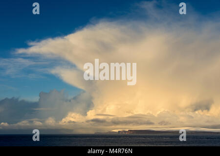 Cumulonimbus cloud over the island of Hoy, Orkney Isles, and the Pentland Firth, from near the village of Mey, Caithness, - Stock Photo