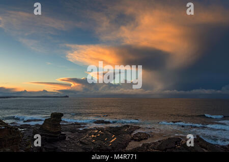 Cumulonimbus cloud at sunset over Dunnet Head and the Pentland Firth, from one of the Men of Mey sea stacks, St. - Stock Photo