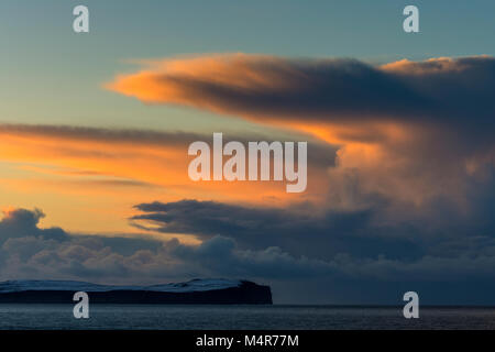 Cumulonimbus cloud at sunset over Dunnet Head and the Pentland Firth, from St. John's Point, Caithness, Scotland, - Stock Photo