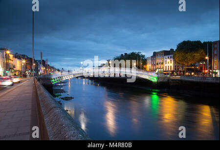 Ha'penny Bridge  in Dublin, Ireland is a pedestrian cast iron bridge built in May 1816 over the river Liffey. The - Stock Photo