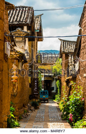 Back lanes with buildings made of mud brick (adobe) in the market town of Shaxi, on the Tea Horse Caravan Road, - Stock Photo