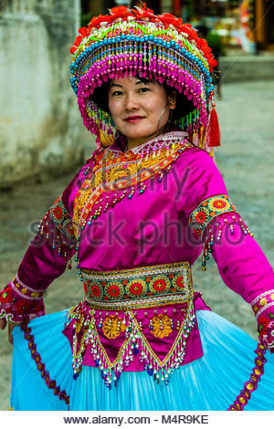 A woman of the Miao ethnic minority wearing traditional clothing, in the Old Town (Dayan) of Lijiang, Yunnan Province, - Stock Photo