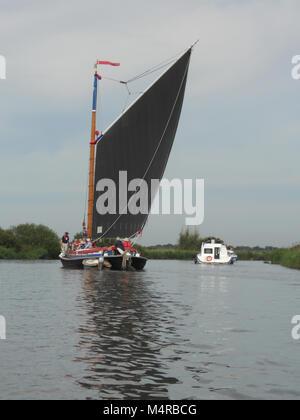 Norfolk Wherry  and Cruiser on River Bure - Stock Photo