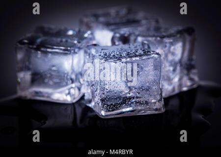 Many ice cubes on black reflection background - Stock Photo
