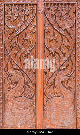 UNESCO; Carving pattern with the dragon symbol in the traditional Thai style on the wooden door of & Wooden door with carving of the traditional Thai welcome known as ...