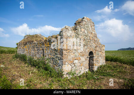 The ruins of St. Nessan's Church, Ireland's Eye, Howth Head, County Dublin, Ireland. - Stock Photo