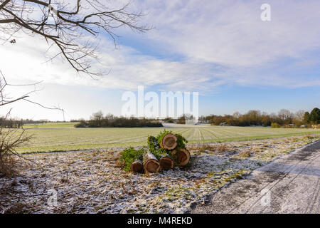 Color outdoor snowy landscape panorama of a morning winter countryside with blue sk, clouds, sunlight and a view - Stock Photo