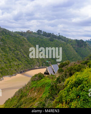 Scenic color outdoor nature image of the estuary of Kaimaans river,garden route,South Africa with surrounding hills,railway - Stock Photo