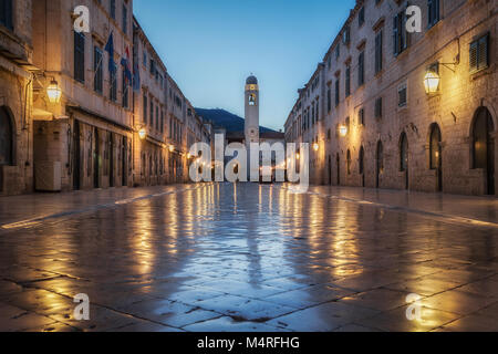 Classic panoramic view of famous Stradun, the main street of the old town of Dubrovnik, in beautiful morning twilight - Stock Photo