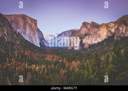Classic Tunnel View of famous Yosemite Valley in beautiful post sunset twilight during blue hour at dusk in summer, - Stock Photo