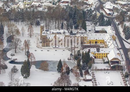 Aerial view, hunting lodge Herdringen Tudor castle in the snow, Neheim, Arnsberg, Sauerland, North Rhine-Westphalia, - Stock Photo