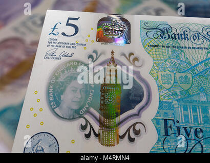 London, UK: December 09, 2016: The new 2016 polymer five pound note with enhanced counterfeit resilience showing - Stock Photo